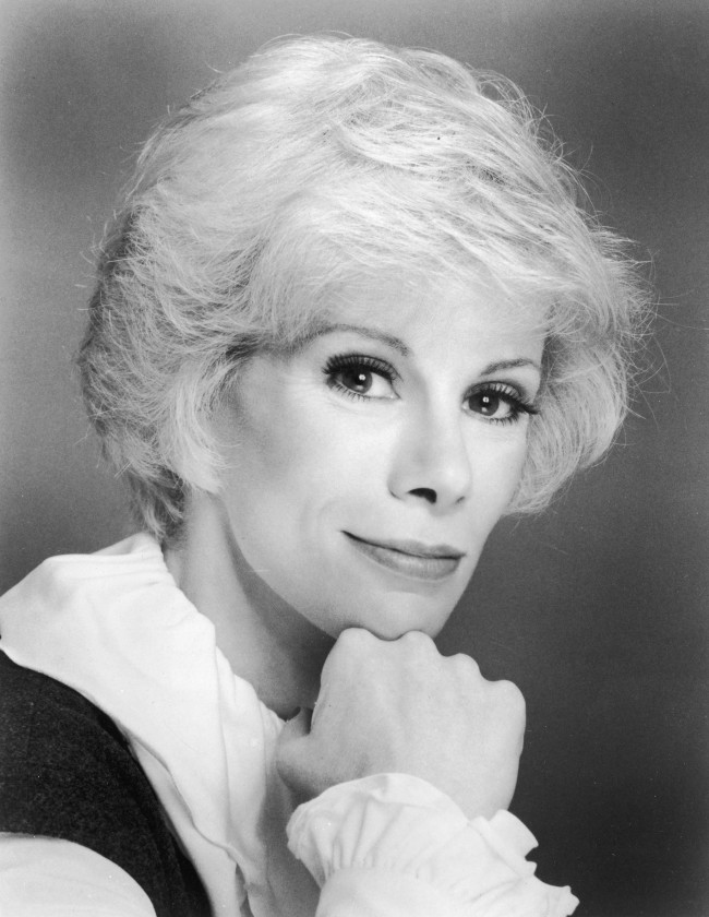 :Headshot portrait of American comedian Joan Rivers leaning her face against her fist, 1960s.