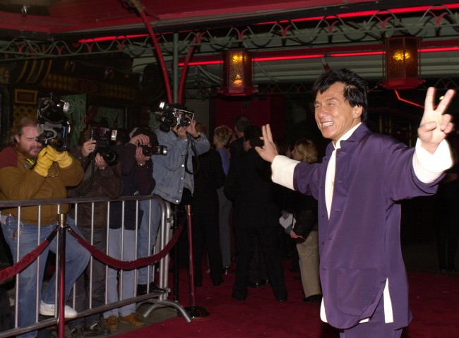 Caption:382818 09: Actor Jackie Chan arrives at the Universal Pictures and Beacon Pictures premiere of 'The Family Man' December 12, 2000 at Mann''s Chinese Theatre in Hollywood, CA. (Photo by Chris Weeks/Liaison)