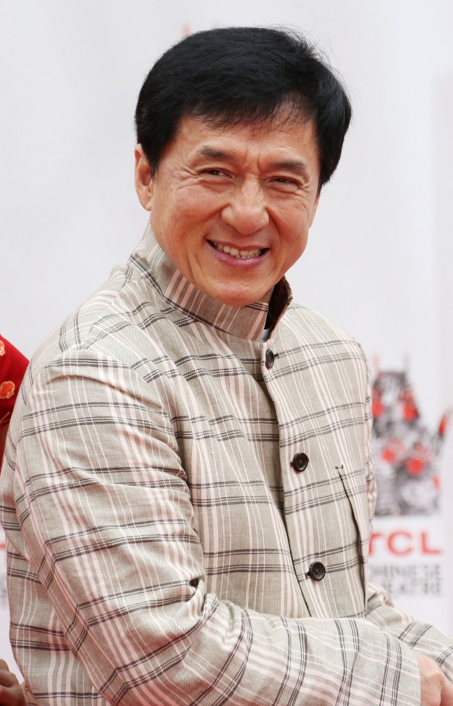 Caption:HOLLYWOOD, CA - JUNE 06: Actor Jackie Chan during the Jackie Chan Hand and Foot Print Ceremony at the TCL Chinese Theatre on June 6, 2013 in Hollywood, California. (Photo by Frederick M. Brown/Getty Images)