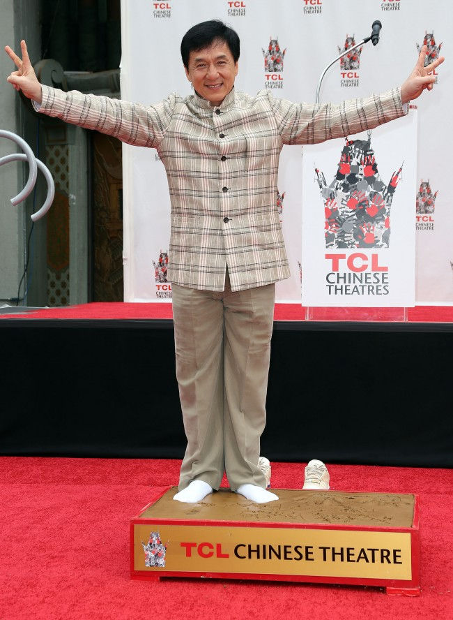 Caption:HOLLYWOOD, CA - JUNE 06: Actor Jackie Chan poses during the Jackie Chan Hand and Foot Print Ceremony at the TCL Chinese Theatre on June 6, 2013 in Hollywood, California. (Photo by Frederick M. Brown/Getty Images)