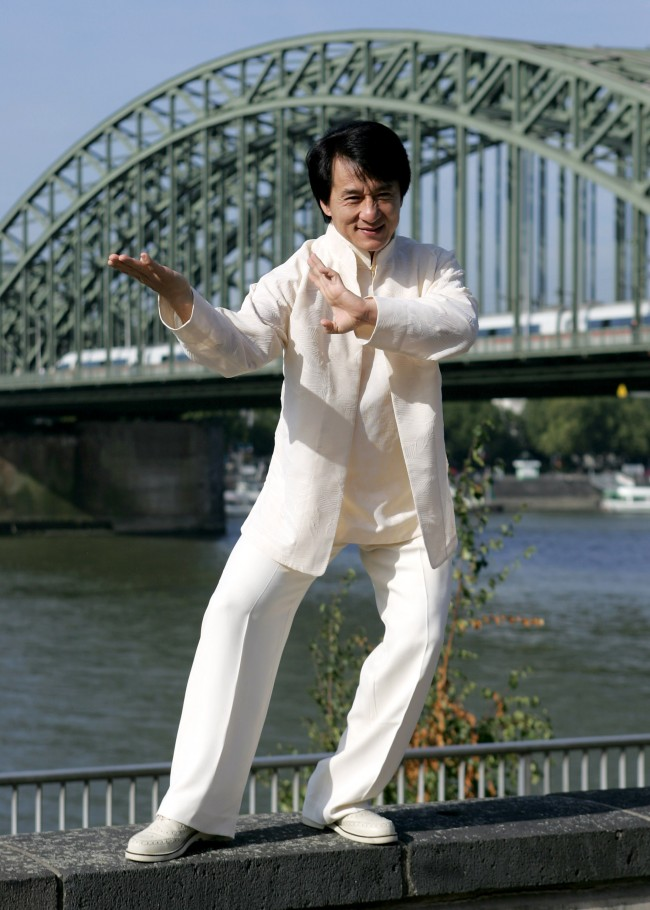 Caption:COLOGNE, GERMANY - OCTOBER 10: Actor Jackie Chan poses in front of a river Rhine bridge prior to tonight's premiere of his new film, 'New Police Story' on October 10, 2005 in Cologne, Germany. (Photo by Juergen Schwarz/Getty Images)