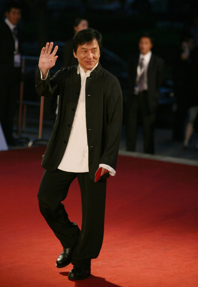 Caption:SHANGHAI, CHINA - JUNE 14: (CHINA OUT) Action star Jackie Chan waves on the red carpet upon his arrival to attend the opening ceremony of the 11th Shanghai International Film Festival on June 14, 2008 in Shanghai, China. The festival will be held from June 14 to 22. (Photo by China Photos/Getty Images)