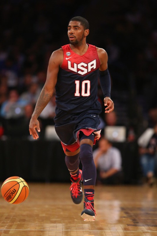 NEW YORK, NY - AUGUST 22: Kyrie Irving #10 of the USA dribbles against Puerto Rico during their game at Madison Square Garden on August 22, 2014 in New York City