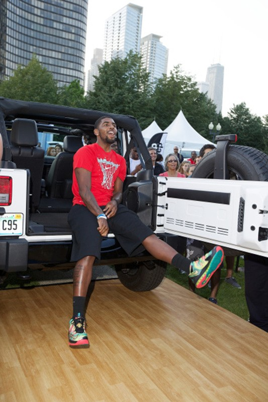 CHICAGO, IL - AUGUST 15: NBA player Kyrie Irving attends Kyrie Irving, Jalen Rose, and Jalen Rose Leadership Academy Students Celebrate the Summer of Jeep at Navy Pier on August 15, 2014 in Chicago, Illinois