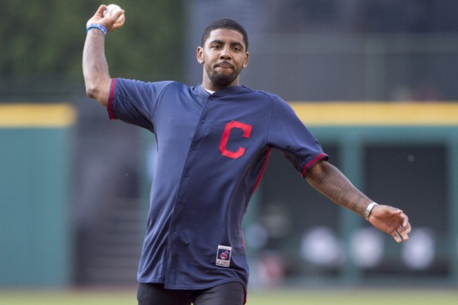 CLEVELAND, OH - JUNE 16: Kyrie Irving of the NBA Cleveland Cavaliers throws out the first pitch prior to the game between the Cleveland Indians and the Los Angeles Angels of Anaheim at Progressive Field on June 16, 2014 in Cleveland, Ohio.