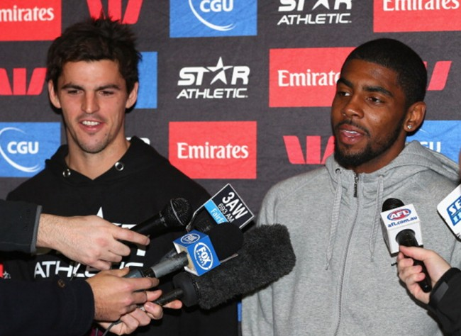 MELBOURNE, AUSTRALIA - JULY 01: Scott Pendlebury of the Magpies and Kyrie Irving of the Cleveland Cavaliers NBA team speak to the media during a Collingwood Magpies appearance at Westpac Centre on July 1, 2013 in Melbourne, Australia