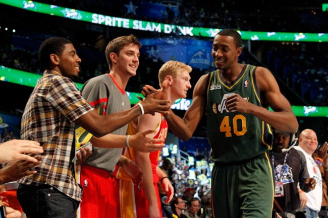 ORLANDO, FL - FEBRUARY 25: Jeremy Evans (R) of the Utah Jazz is congrated by (from L) Kyrie Irving of the Cleveland Cavaliers, Chandler Parsons and Chase Budinger (both) of the Houston Rockets during the Sprite Slam Dunk Contest part of 2012 NBA All-Star Weekend at Amway Center on February 25, 2012 in Orlando, Florida. NOTE TO USER: User expressly acknowledges and agrees that, by downloading and or using this photograph, User is consenting to the terms and conditions of the Getty Images License Agreement