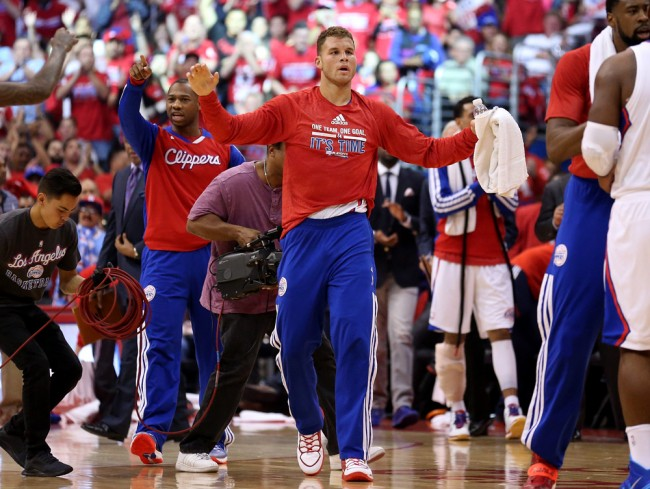 LOS ANGELES, CA - APRIL 21: Blake Griffin #32 of the Los Angeles Clippers greets teammates during a timeout in the game with the Golden State Warriors in Game Two of the Western Conference Quarterfinals during the 2014 NBA Playoffs at Staples Center on April 21, 2014 in Los Angeles, California. The Clippers won 138-98..