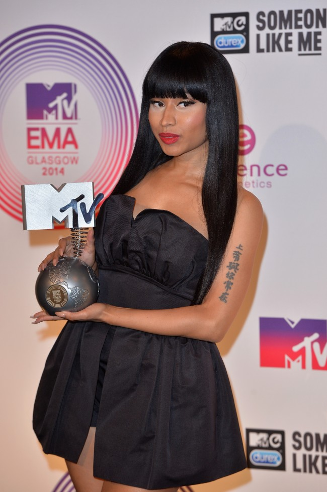 GLASGOW, SCOTLAND - NOVEMBER 09: Nicki Minaj poses backstage with her Best Hip Hop trophy during the MTV EMA's 2014 at The Hydro on November 9, 2014 in Glasgow, Scotland.