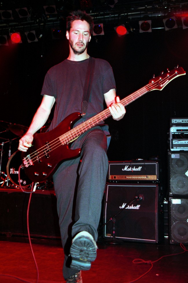 372438 03: Actor Keanu Reeves performs July 7, 2000 with his band 'Dogstar' at Irving Plaza in New York City.