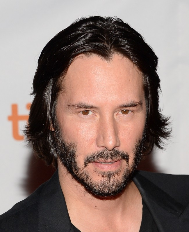 TORONTO, ON - SEPTEMBER 10: Actor Keanu Reeves arrives at the 'Man Of Tai Chi' Premiere during the 2013 Toronto International Film Festival at Ryerson Theatre on September 10, 2013 in Toronto, Canada.