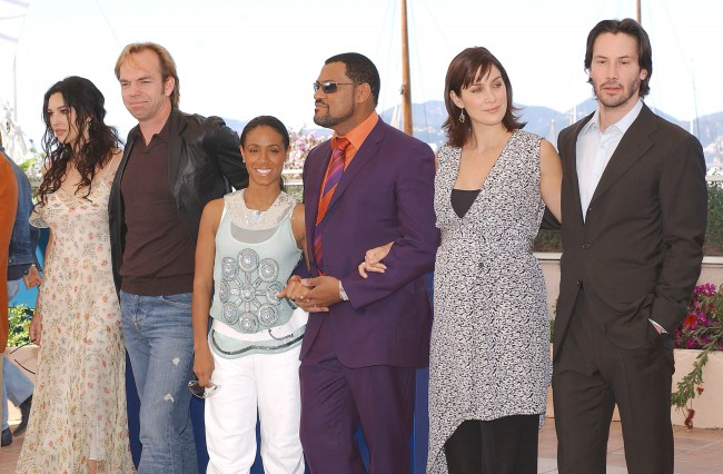 CANNES, FRANCE - MAY 15: (L to R) Actors Monica Bellucci, Hugo Weaving, Jada Pinkett Smith, Laurence Fishburne, Carrie-Anne Moss and Keanu Reeves pose at a photocall for the film 'The Matrix Reloaded' at the 56th International Cannes Film Festival May 15, 2003 in Cannes, France.
