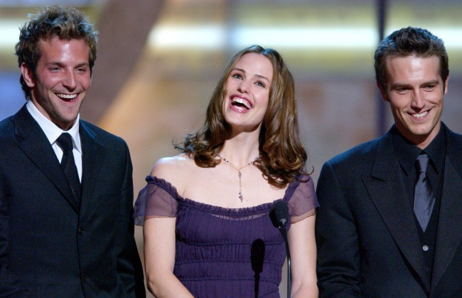 Actress Jennifer Garner speaks as actors Bradley Cooper (L) and Michael Vartan look on during the 28th Annual Peoples Choice Awards at the Pasadena Civic Center January 13, 2002 in Pasadena, CA. 'Alias' won Favorite New Television Dramatic Series.