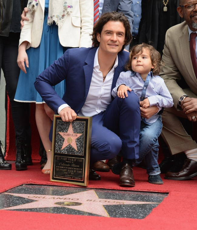 HOLLYWOOD, CA - APRIL 02: Actor Orlando Bloom and his son Flynn Bloom attend the Hollywood Walk of Fame celebration in honor of Orlando Bloom on April 2, 2014 in Hollywood, California.