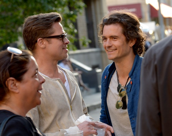 Actor/producer Brad Pitt and actor Orlando Bloom attend the Paris Photo Los Angeles private preview at Paramount Studios on April 24, 2014 in Hollywood, California.