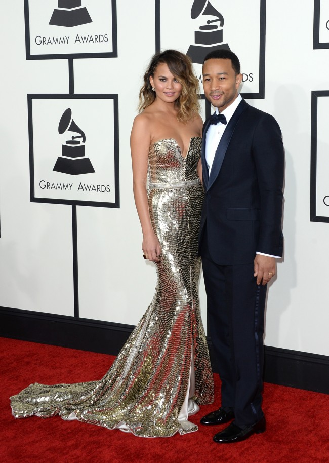 LOS ANGELES, CA - JANUARY 26: Model Christine Teigen (L) and singer John Legend attend the 56th GRAMMY Awards at Staples Center on January 26, 2014 in Los Angeles, California.