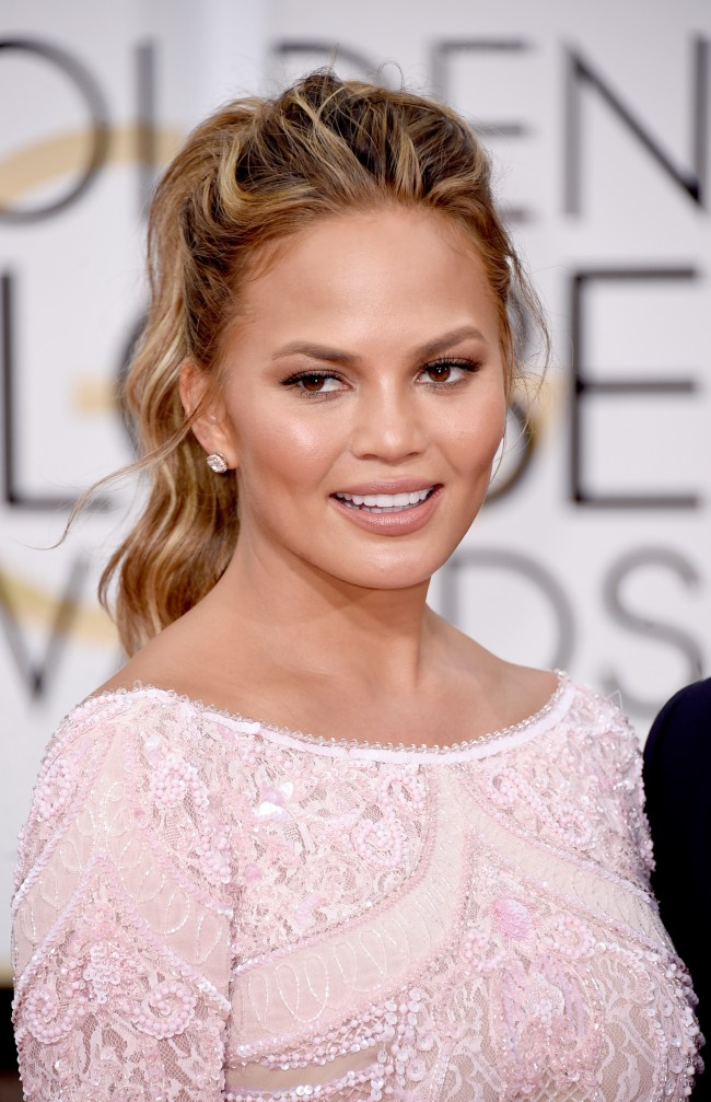 BEVERLY HILLS, CA - JANUARY 11: Model Chrissy Teigen attends the 72nd Annual Golden Globe Awards at The Beverly Hilton Hotel on January 11, 2015 in Beverly Hills, California.