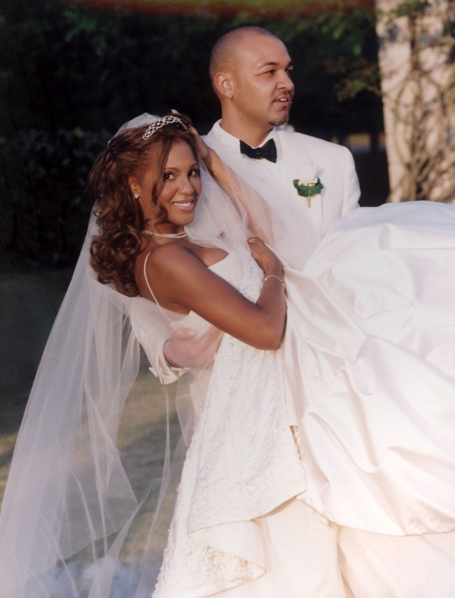 Keri Lewis, right, the keyboardist for the band Mint Condition, holds his new bride, singer Toni Braxton, April 21, 2001 in Alpharetta, GA. The couple wed in a private outdoor ceremony.