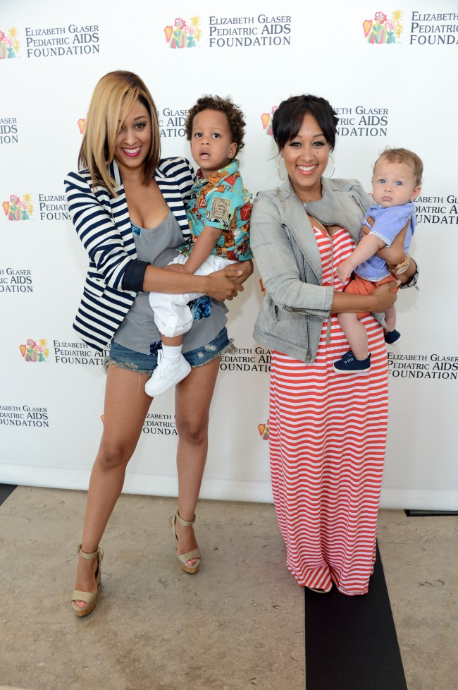 LOS ANGELES, CA - JUNE 02: Actresses Tia Mowry-Hardrict (L), Tamera Mowry-Housley (2nd R) and family attend the Elizabeth Glaser Pediatric AIDS Foundation's 24th Annual 'A Time For Heroes' at Century Park on June 2, 2013 in Los Angeles, California.