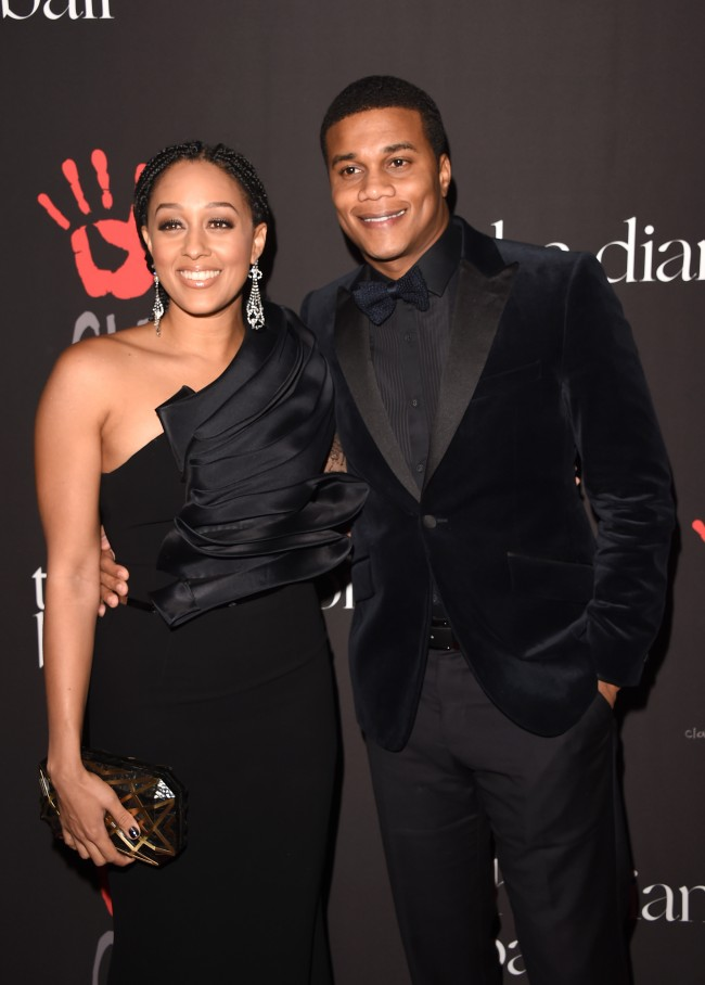 Actors Cory Hardrict (R) and Tia Mowry-Hardrict attend Rihanna's First Annual Diamond Ball at The Vineyard on December 11, 2014 in Beverly Hills, California.