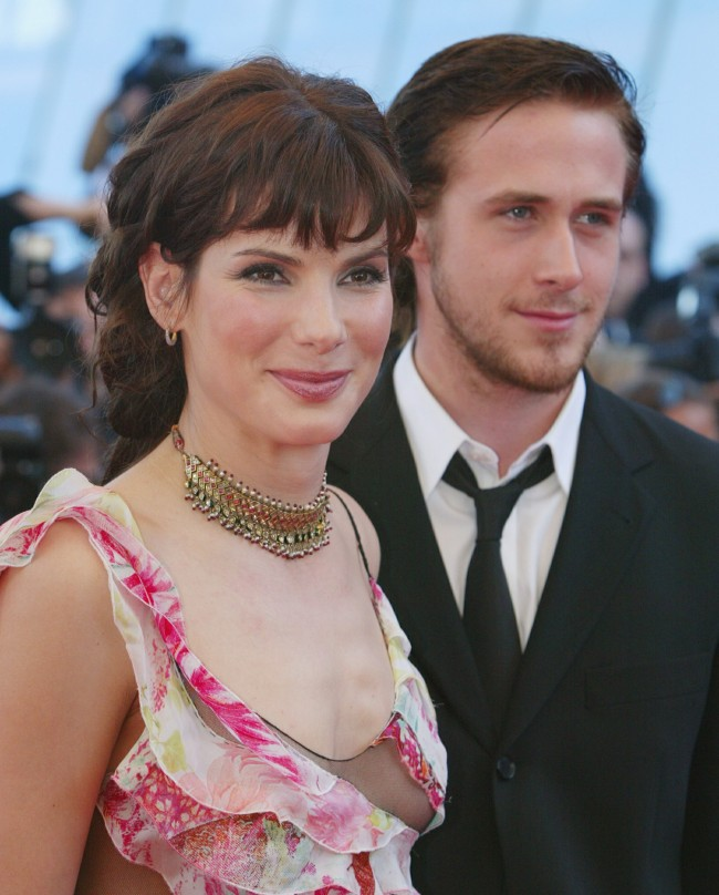 American actress Sandra Bullock (L) and actor Ryan Gosling arrive at the Festival Palace before the screening of the film ' Murder by Numbers' Friday, May 24, 2002 at the 55th International Film Festival in Cannes, France.