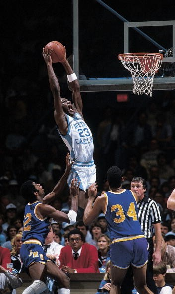 College Basketball: NCAA playoffs, North Carolina Michael Jordan (23) in action, making dunk vs James Madison, Greensboro, NC 3/19/1983
