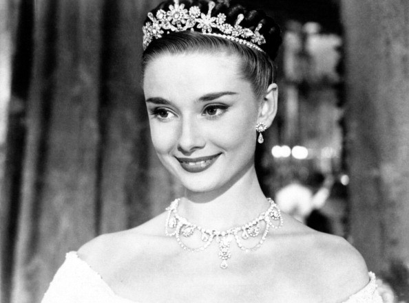 The actress Audrey Hepburn, wearing a tiara, is the beautiful Princess Ann in the movie Roman Holiday. Rome, 1953.