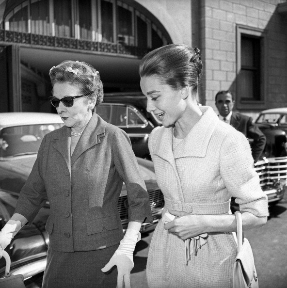 British actress Audrey Hepburn (Audrey Kathleen Ruston) walking with her mother, the Dutch baroness Ella Van Heemstra. Rome, 1950s.