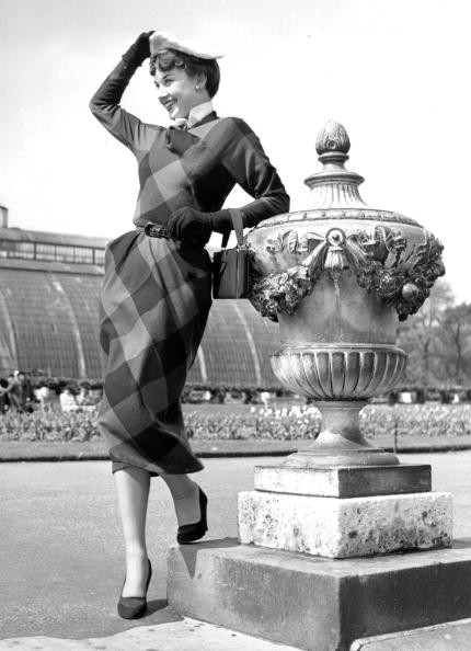 1st May 1950: Belgian born actress Audrey Hepburn (1929 - 1993) leaning on an ornate urn in Kew Gardens.