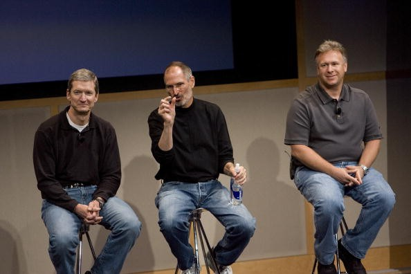 Tim Cook, Steve Jobs and Phil Schiller, answers questions after Jobs introduced new versions of the iMac and iLife applications August 7, 2007 in Cupertino, California. The all-in-one desktop computers now have a slimmer design in aluminum casings with faster chips and glossy screens and is up to $300 cheaper then their predecessors.