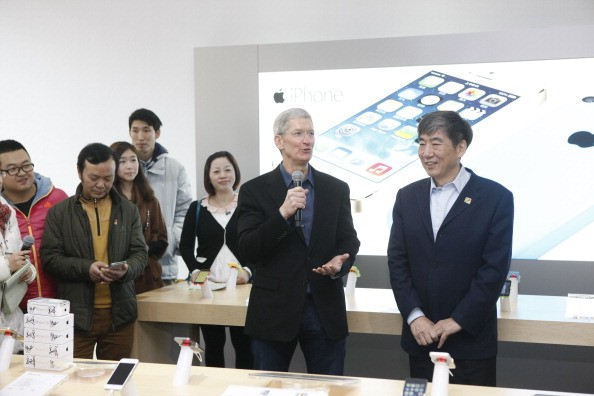 Tim Cook, Chief Executive Officer of Apple Inc., and China Mobile Chairman Xi Guohua (R) visit a China Mobile shop to celebrate the launch of iPhone 5S and iPhone 5C on China Mobile's fourth generation (4G) network on January 17, 2014 in Beijing, China. Apple Inc. and China Mobile Limited, the world's largest carrier with over 760 million subscribers, signed a deal on December 23, 2013 after six years of negotiations.