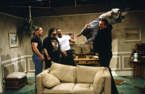 SATURDAY NIGHT LIVE -- Episode 15 -- Pictured: (l-r) Triple H, Mick Foley, The Rock as Nic Katrel, Chris Parnell as Husband, Big Show during the 'Nicotrel' skit on March 18, 2000