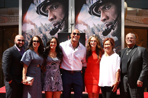 Dwayne 'The Rock' Johnson (C) and his family attend the hand/footprint ceremony honoring Dwayne 'The Rock' Johnson held at TCL Chinese Theatre IMAX on May 19, 2015 in Hollywood, California.