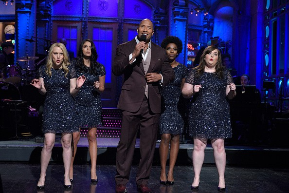 SATURDAY NIGHT LIVE -- 'Dwayne Johnson' Episode 1678 -- Pictured: (l-r) Kate McKinnon, Cecily Strong, Dwayne Johnson, Sasheer Zamata and Aidy Bryant during 'Dwayne Johnson's Franchise Viagra Monologue' on March 28, 2015