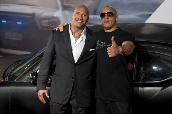 Dwayne Johnson (The Rock) and Vin Diesel (R) pose for photographers during the premiere of the movie 'Fast and Furious 5' at Cinepolis Lagoon on April 15, 2011 in Rio de Janeiro, Brazil.