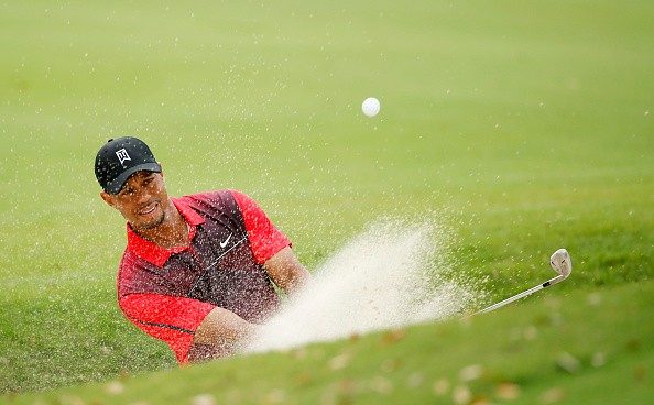 Tiger Woods plays a bunker shot on the fourth hole during the final round of the Hero World Challenge at the Isleworth Golf & Country Club on December 7, 2014 in Windermere, Florida.