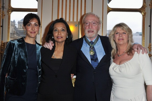 Actor Sir Michael Caine poses with daughters Natasha (L) and Dominique (R) and his wife Shakira (2ndL) after being awarded 'Commandeur des arts et des lettres' by French Culture Minister Frederic Mitterrand at Ministere de la Culture on January 6, 2011 in Paris, France.