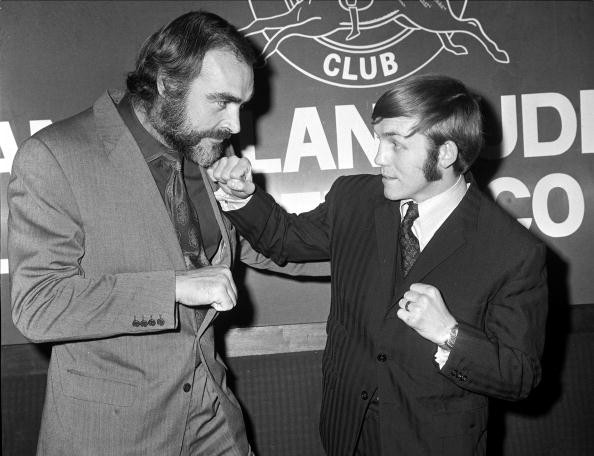 Scottish actor Sean Connery (left) best known for his film role as James Bond, poses with Alan Rudkin, the British Bantamweight Champion at a London reception.