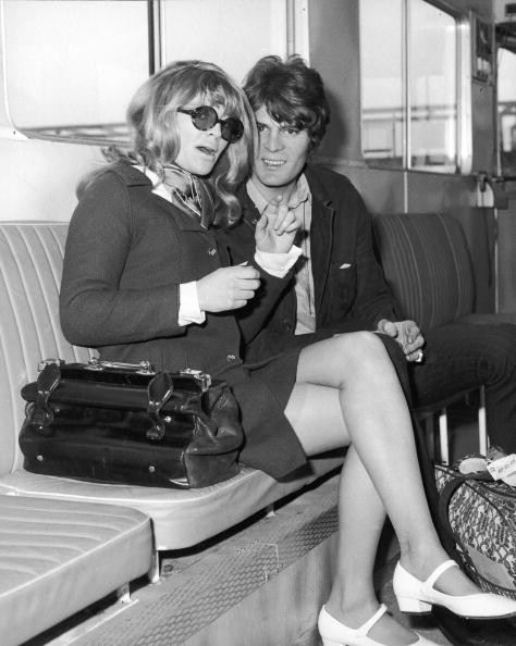 British actor Julie Christie and her fiance Don Bessant sit aboard an airport shuttle bus en route to a flight to Los Angeles, California, where Christie was to attend the Academy Awards, London Airport, England, April 16, 1966. Christie was nominated and won for Best Actress for her role in the film, 'Darling.'