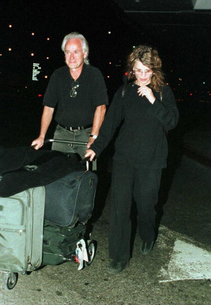 Actress Julie Christie and her longterm boyfriend Duncan Campbell, a British journalist, arrive at Los Angeles International Airport on October 11, 2000 in Los Angeles, CA.