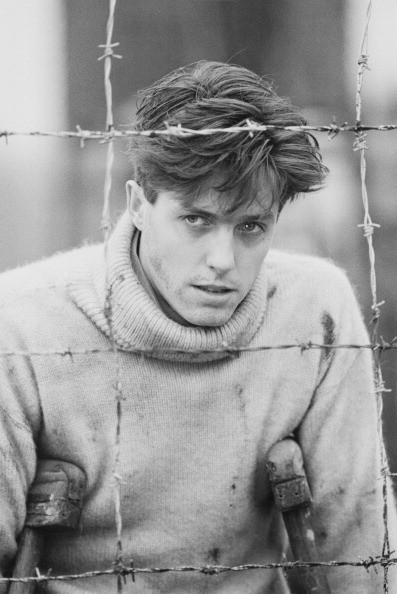 English actor Hugh Grant pictured in character as 'Peter Baines' on the set of the television film 'Jenny's War' on 8th November 1984.