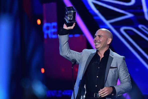 Caption:MIAMI, FL - JULY 16: Pitbull accepts award onstage at Univision's Premios Juventud 2015 at Bank United Center on July 16, 2015 in Miami, Florida. (Photo by Rodrigo Varela/Getty Images For Univision)