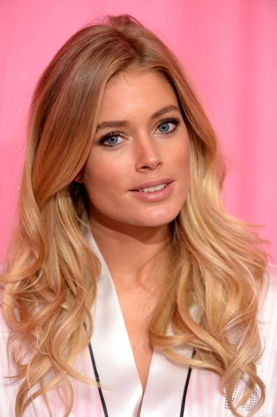 Model Doutzen Kroes prepares at the 2013 Victoria's Secret Fashion Show hair and make-up room at Lexington Avenue Armory on November 13, 2013 in New York City.