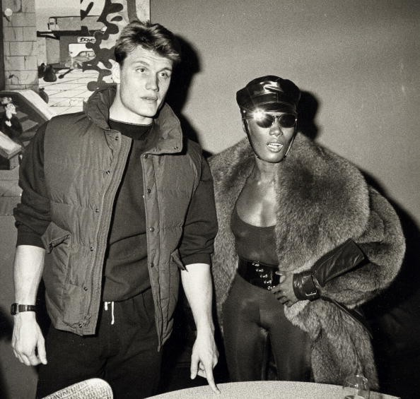 Actor Dolph Lundgren and singer Grace Jones attending 'Grace Jones Concert Party' on January 1, 1984 at the Kamikaze Club in New York City, New York.