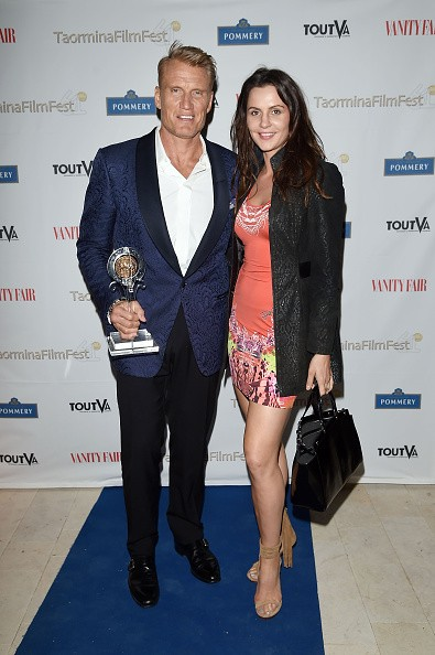 Dolph Lundgren and Jenny Sandersson attend the Vanity Fair and Pommery Gala Dinner - 61st Taormina Film Fest on June 18, 2015 in Taormina, Italy.