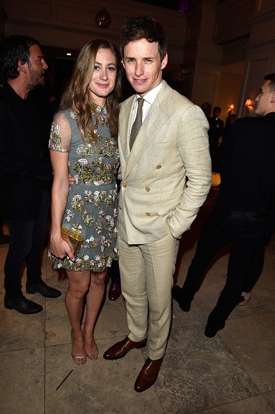 Hannah Bagshawe (L) and actor Eddie Redmayne attend Hollywood Foreign Press Association & InStyle's annual celebration of The Toronto International Film Festival at Windsor Arms Hotel on September 12, 2015 in Toronto, Canada.