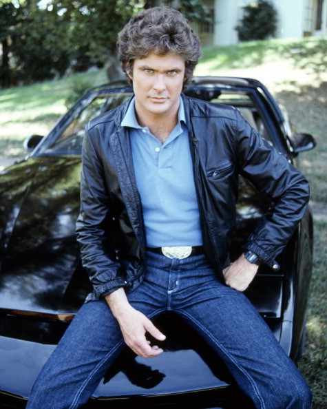 American actor David Hasselhoff, star of the TV show 'Knight Rider' sitting on KITT, the artificially intelligent supercar featured in the series, circa 1983.