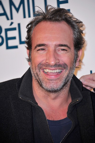 Jean Dujardin attends the 'La Famille Belier' Paris Premiere at Le Grand Rex on December 9, 2014 in Paris, France. (Photo by )
