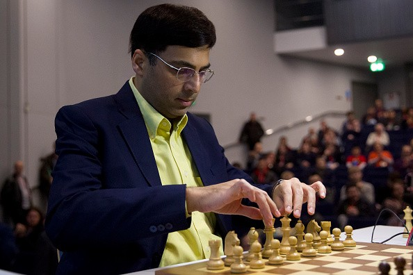 Indian chess player Vishy Anand prepares to make a move during his match against British chess player Michael Adams during the London Chess Classic tournament, part of the Grand Chess Tour 2015, in London on December 4, 2014.