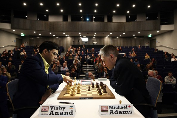 Super-grandmaster Vishy Anand makes a move against British chess champion Michael Adams in an opening game at the London Chess Classic tournament on December 4, 2015 in London, England. As well as a British knockout championship, the tournament will see nine super-grandmasters compete in the final leg of the Grand Chess Tour.